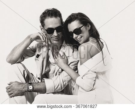Beautiful young couple hugging and smiling