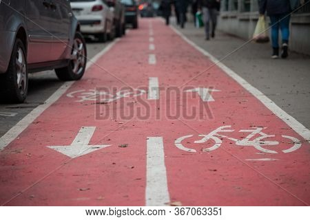 Bicyle Lane, On A Bike Path Infrastructure, With Its Distinctive Logo Looking Like A Cycle In The Fo
