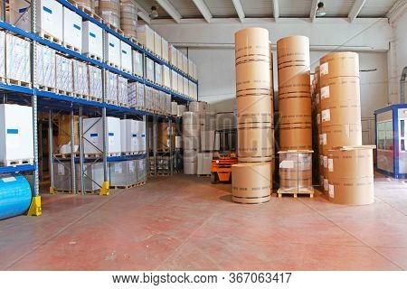 Big Stack Of Toilet Paper Rolls In Warehouse