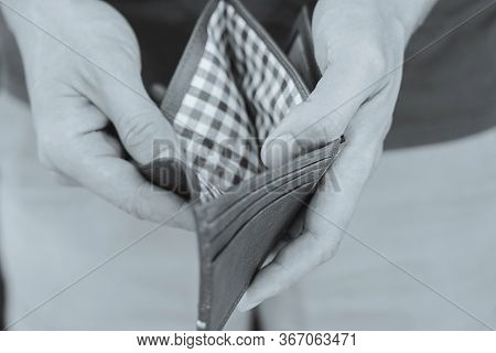 Black And White Image Of Man Hands Holding Empty Wallet, No Money To Spend, Jobless Or In Debt, Bank