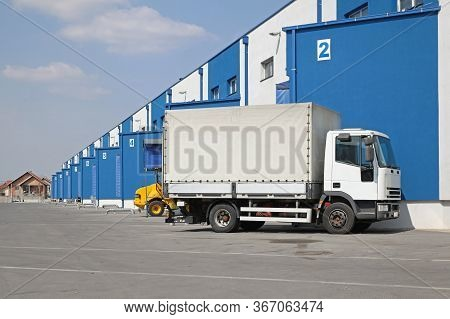 Truck At Loading Dock Distribution Warehouse Shipping