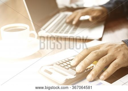 Man Hand On Laptop Keyboard For Work From Home, Overhead View Of Businessman Working  In Office
