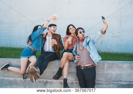 Group Of Friends Taking A Selfie With Phone.
