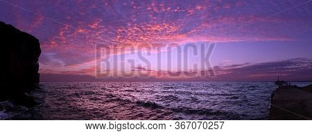 Dramatic Ocean Scenics With Purple Sky Just After Sunset