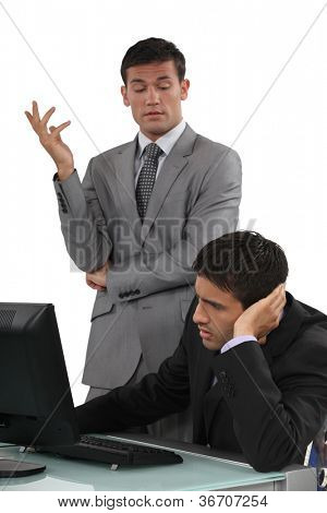 Arrogant businessman talking to his colleague