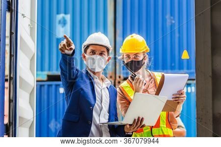 Engineer And Worker Team Wearing Protection Face Mask Against Coronavirus, Foreman In Hardhat And Sa