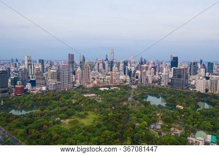 Aerial View Of Green Trees In Lumpini Park, Sathorn District, Bangkok Downtown Skyline. Thailand. Fi