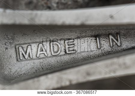 Made In - Convex Inscription Casting Alloy On The Spokes Of An Aluminum Cast Wheel