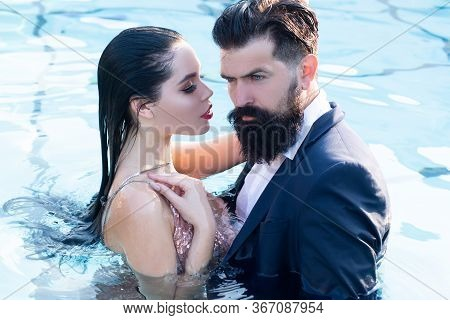 Couple In Dress Having Party In Swimming Pool. Celebrity Couple, Fashionable Pair Of Elegant People.