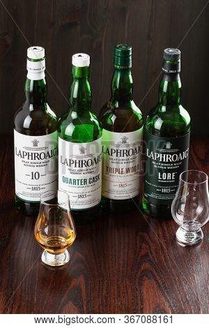 Trondheim, Norway - Mai 18 2020: Laphroaig single malt scotch whisky 10 years, quarter cask, lore, triple wood bottle and glass