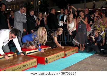LOS ANGELES - SEP 11:  Simon Cowell, Britney Spears, Demi Lovato at the FOX  X-Factor Judges Handprint Ceremony at Graumans Chinese Theater on September 11, 2012 in Los Angeles, CA