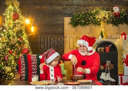 Gift Emotions. Happy Little Child Son With Grandfather Dressed In Winter Clothing Think About Santa