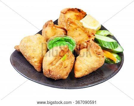 Indian Cuisine - Many Samosas (fried Savoury Pastry) On Black Plate Isolated On White Background