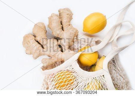 Package-free Food Shopping. Reusable String Shopping Bag With Banana, Orange, Lemon And Ginger Isola