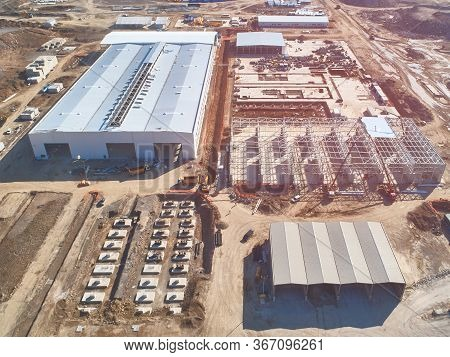 Prefabricated Frame Industrial Buildings And Building Materials Warehouse At Construction Site Top D
