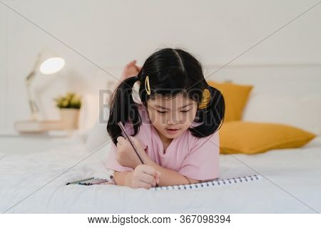Young Asian Girl Drawing At Home. Asia Japanese Woman Child Kid Relax Rest Fun Happy Draw Cartoon In