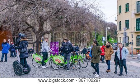 Budapest, Hungary - 03 16 2019 : Young Tourists Use The Mols Bubi Bikes At The Buda Castle Tunnel.
