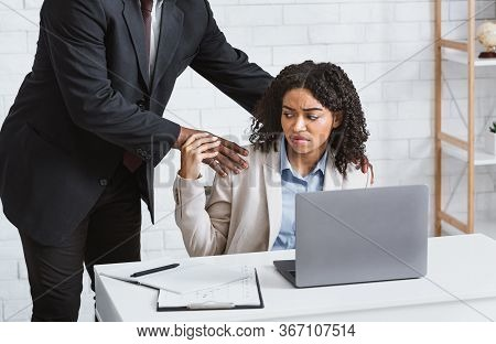 Workplace Harassment Concept. Disgusted Female Secretary Stopping Her Boss From Molesting Her At Com