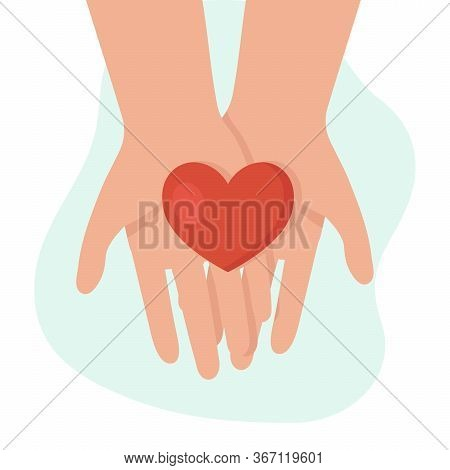 Human Hands Holding A Heart. Concept Of Help, Support, Charity. Charity Fund. Support For Women In D
