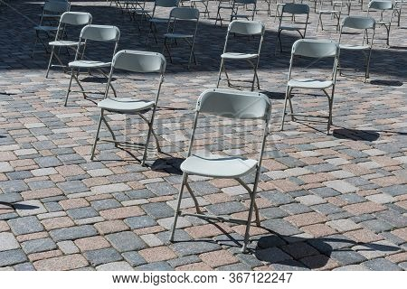Social Distancing During Covid Or Coronavirus Crisis, Chairs Keeping Distance During A Show, Concert