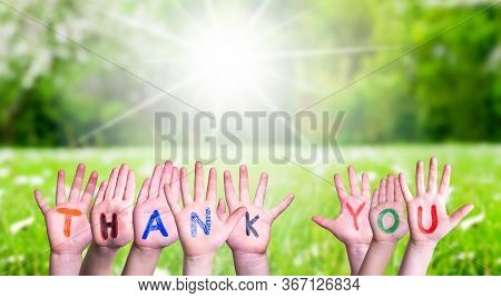 Many Children Hands Building Word Thank You, Grass Meadow