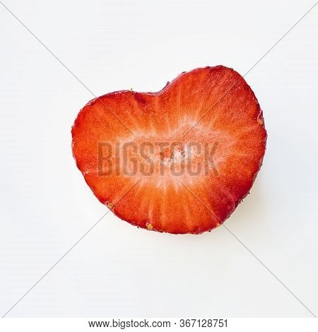 Isolated Close Up Heart Shape Ripe Red Strawberry Cut In Half On A White Background. Macro Square Im
