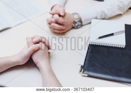 Hand, Two Men On A Desk. Negotiating Business. Communication And Negotiations Between Two Businessme
