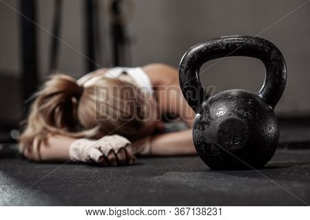 Drained Female Bodybuilder After Hard Crossfit Training At Gym
