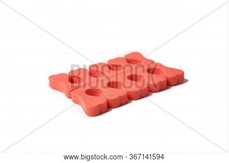 Toe Separator Isolated On A White Background. Pair Of Toe Separator In The Form Of Small Hearts. Spo