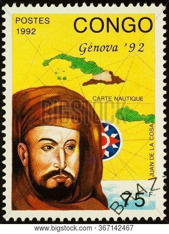 Moscow, Russia - May 19, 2020: Stamp Printed In Congo Shows Portrait Of Juan De La Cosa (1450-1510),