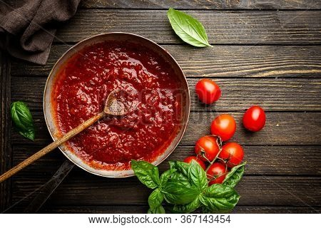 Classic Homemade Italian Tomato Sauce With Basil For Pasta And Pizza In The Pan On Wooden Background