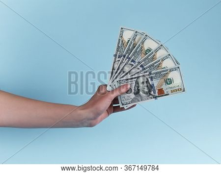 Hand Holding Hundred Dollars. Giving Money. 500 American Usd Isolated In Hand