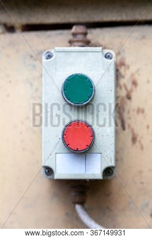 Two Green And Red Buttons Remote, Industrial Machinery Operation Pad Frontal Shot, Closeup. On And O