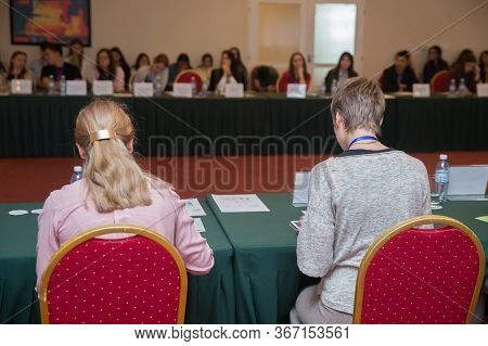People At The Conference Hall. Rear View . Business Meeting In A Conference Hall. Rear View Of The P