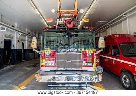 Montreal, Ca - 2 May 2015: Firetruck In Montreal Plateau Fire Station, Canada