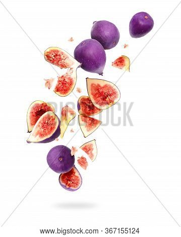 Whole And Sliced Ripe Figs In The Air, Isolated On A White Background
