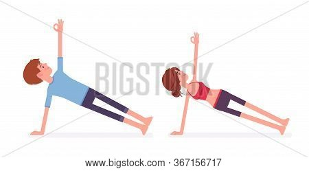 Young Yogi Man And Woman In Sports Wear Practicing Yoga, Partners Doing Vasisthasana Pose, Side Plan
