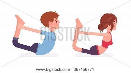 Young Yogi Man And Woman In Sports Wear Practicing Yoga, Partners Doing Dhanurasana Pose, Bow Exerci