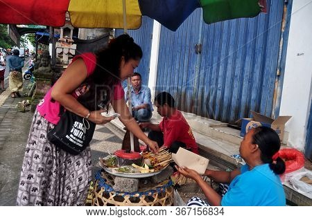 Indonesian People And Foreigner Travelers Buying And Taste Eats Local Street Food Bali Style From Ha