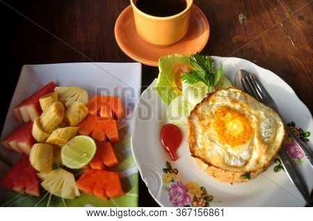 American Breakfast Or Continental Breakfasts Bali Style In Dining Room In Morning Time For Travelers