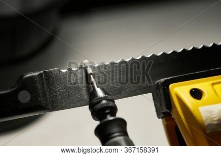 Professional Serrated Knife Blade Sharpening With A Rotary Tool. Macro Shot