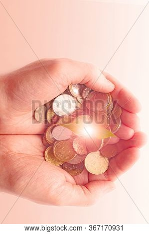 Green Sprout Sprouts From A Pile Of Coins In Male Hands. Gold Gradient. Invest Your Money To Get Inc