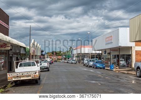 Ficksburg, South Africa - March 20, 2020: A Street Scene, With Businesses And Vehicles, In Ficksburg