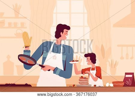 Cheerful Dad And Son Cooking Pancakes Together At Home In The Kitchen. The Concept Of Happy Fatherho