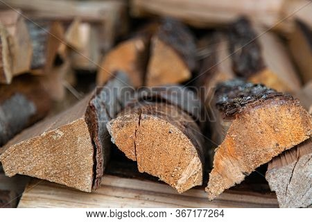 Close Up Pine Wood Stacked In A Woodpile.