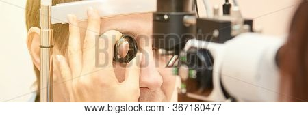 Eye Doctor Diagnostic. Patient At Medical Clinic. Cataract Ophthalmology Exam. Astigmatism Examinati