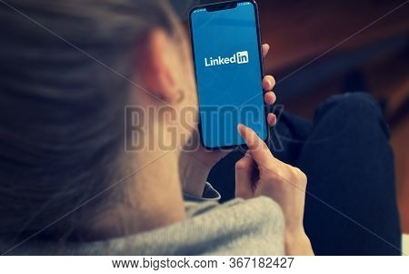 Kyiv, Ukraine-january, 2020: Linkedin On Smartphone Screen. Young Girl Pointing Or Texting Smart Pho