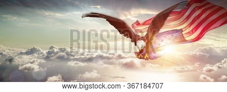 Eagle With American Flag Flying Over The Clouds