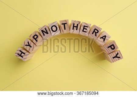 Wooden Blocks With Word Hypnotherapy On Yellow Background, Flat Lay