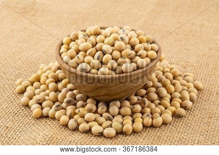 Soy Beans In A Wooden Bowl On Sack Cloth. Soybean Is A Kind Of Legume Native To East Asia.